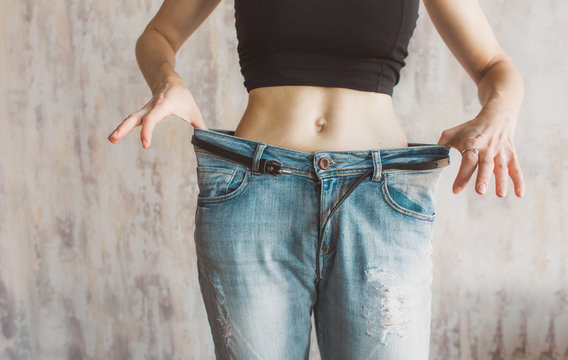 Slimming woman wearing big pants. before and after losing excess weight