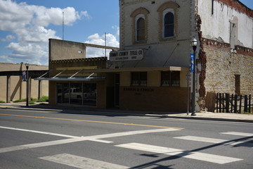 Local businesses are seen in downtown Carizzo Springs