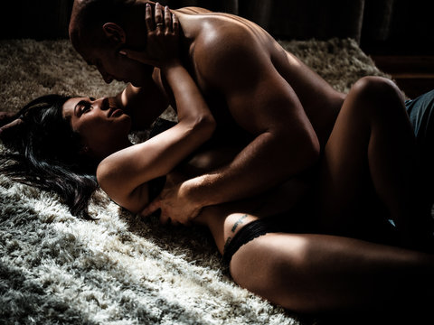 Young beautiful couple makes love at home