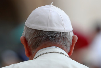Pope Francis wears his hat at the Vatican