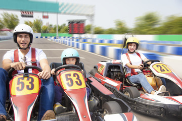 happy family driving go kart on the track