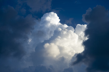 Abstract view of dramatic light and dark puffy summer thunderstorm clouds  Fototapete