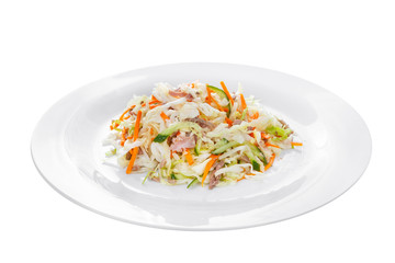 Salad of vegetables with cucumber, carrots, cabbage, meat, ham, bacon on plate, white isolated background Side view. For the menu, restaurant, bar, cafe