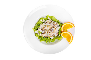 Salad with seafood, squid, mussels, cheese, egg, lettuce, orange on plate, white isolated background, view from above, for the menu restaurant bar cafe