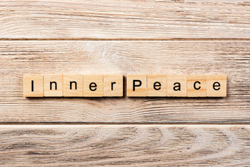 inner peace word written on wood block. inner peace text on table, concept