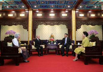China's President Xi Jinping and his wife Peng Liyuan meet with Cambodia's King Norodom Sihamoni and his mother, former queen Monique at Diaoyutai State Guesthouse