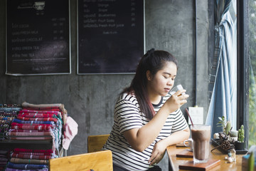 The woman working in a coffee shop.