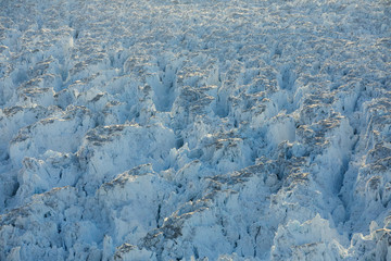 Crevasses form on top of the Helheim glacier near Tasiilaq, Greenland