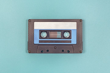 Retro black blue plastic audio cassette tape.