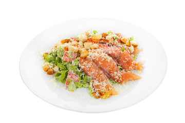 Caesar salad with fish lobes, salmon, trout, biscuits, tomato, lettuce, cheese on plate, white isolated background Side view. For the menu, restaurant bar cafe