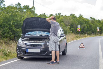 Car malfunction on countryside. Car waiting for help on the road. Car breakdown. Man with car breakdown, phone calling with help