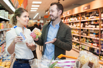 Couple buying milk in supermarket