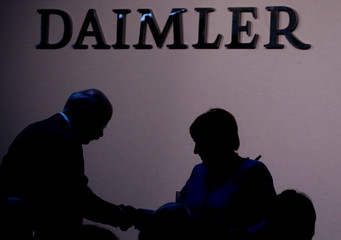 German Chancellor Angela Merkel shakes hands with Daimler CEO Dieter Zetsche during the opening ceremony of the new Daimler Testing and Technology Center in Immendingen
