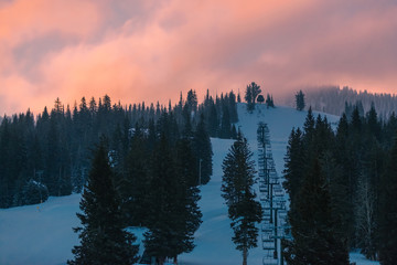 Sunrise Over A Snowy Mountain Ski Resort
