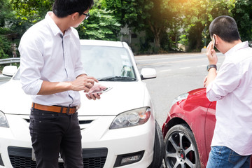 Teenage Driver Making Phone Calling to report car help assistance insurance after an Traffic Accident Defect Engine breakdown  in Stressed situation.