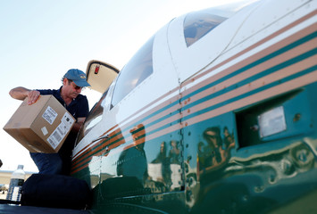 Joseph Pelissier loads supplies into his plane while assisting with operation airlift to deliver supplies to areas hit by Hurricane Florence, now downgraded to a tropical depression, at the Raleigh Durham Airport in Raleigh