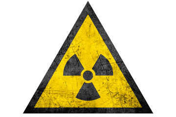 black radioactive sign in yellow riangle