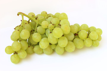 Globe of green grapes on a white background close up