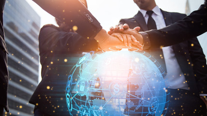 Close up of businessmen shaking hands. Global network and a world map in the foreground. block chain concept. Wall mural