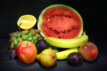 Fresh fruits on a dark background