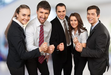 Wall Mural - Business team holding hands together, celebrating success