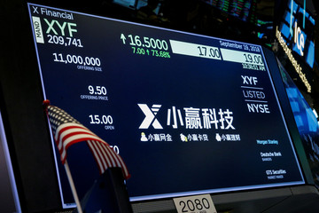 A screen displays the trading information for X Financial, a Chinese technology personal finance company, during the company's IPO at the NYSE in New York