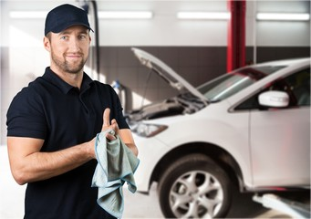 Portrait of cheerful Handsome mechanic on background