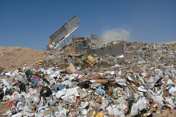 Equipment Working to Control Landfill Waste