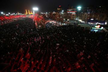 Shi'ite Muslim worshippers pray during commemorations for Ashura in Kerbala