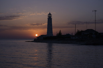 The Tarkhankut lighthouse at sunset. Cape Tarkhankut, south-western cape of the Tarkhankut Peninsula, Crimea