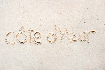 "Handwriting words ""Cote d azur"" on sand"