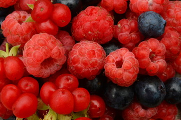 Berries of raspberries and blueberries ripe tasty and beautiful berry pattern