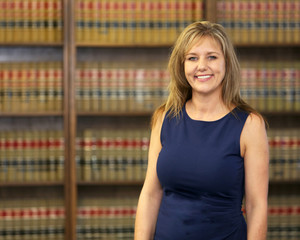 Attractive middle aged mature woman, women in work place, woman lawyer in law office