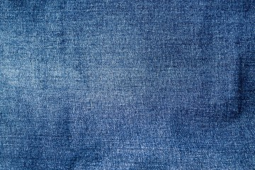 The texture of denim. The background of the blue fabric