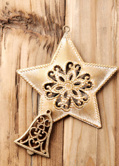 Christmas star and Christmas bell. Rustic wooden background. Top view. Copy space.