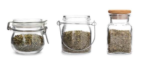 Set of jars with dried parsley on white background