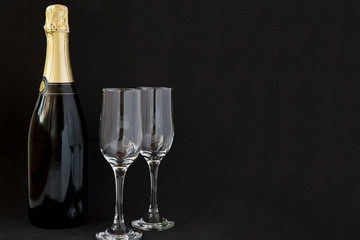 Champagne bottle with champagne glasses.