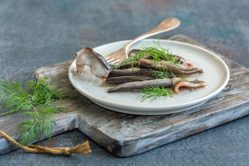 Anchovies in olive oil with fresh dill.