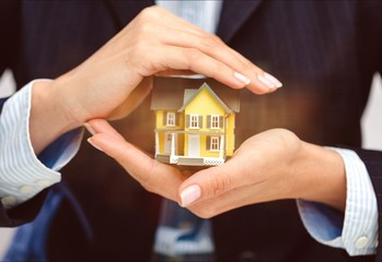 Businessman Holding House Model and Keys, Real