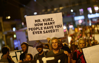 People attend a demonstration against the informal meeting of European Union leaders in Salzburg