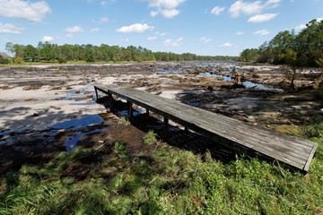 A dock stretches into the empty Patricia Lake after it emptied when its dam collapsed due to massive rainfall from Hurricane Florence, in Boiling Spring Lakes, North Carolina