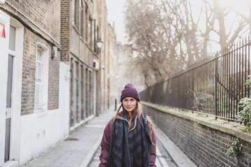 Portrait of woman on street, London, England, UK