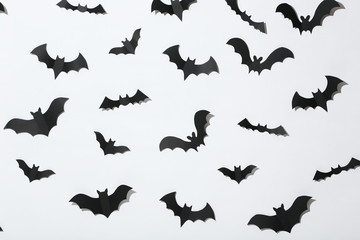Halloween paper bats on white background