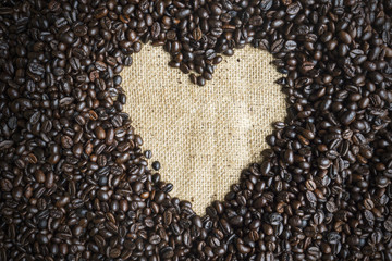 Heart shape on heap coffee beans