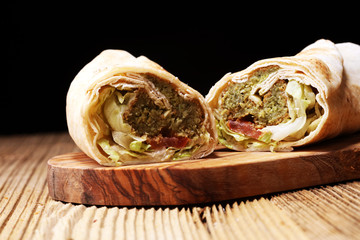 Green falafel with hummus and vegetables in pita bread. Love for a healthy vegan food concept.