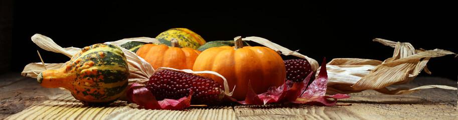 Diverse assortment of pumpkins on a wooden background. Autumn harvest