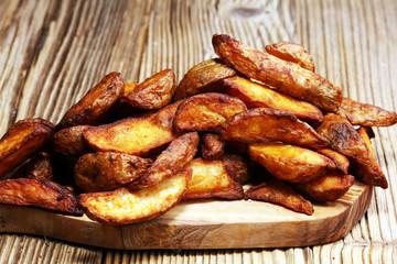 Baked potato wedges. homemade organic vegetable vegan vegetarian potato wedges snack food