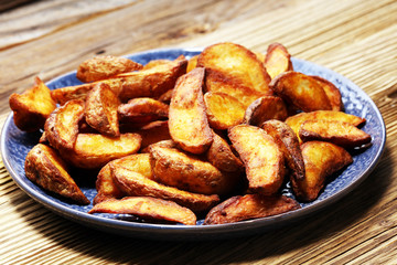 Baked potato wedges. homemade organic vegetable vegan vegetarian potato wedges snack food