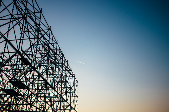 Abstract silhouette of scaffolding against the sunset sky