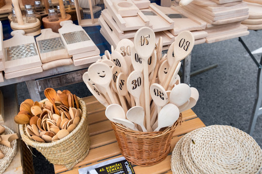 Wooden spoons and other kitchenware at holiday market in Ribnica town. Slovenia